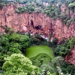 Buraca das araras the best place to see colourful red macaws in the wild in brazil at a beautiful sinkhole