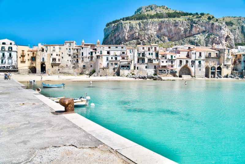 Cefalu sicily jetty - aqua water and a pretty italian city in sicily - a brilliant european buckt list city