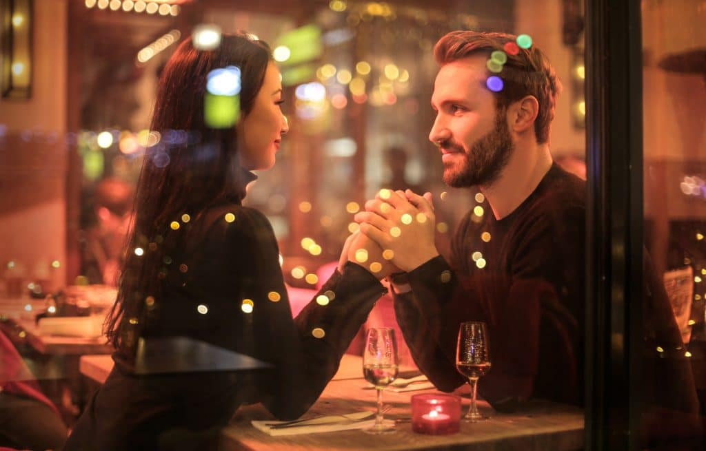 best city breaks for couples - couple enjoying dinner