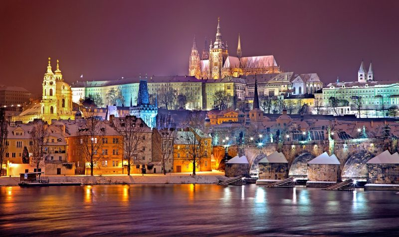 prague is one of the top cities for your europe bucket list, see it lit up at night like this photo