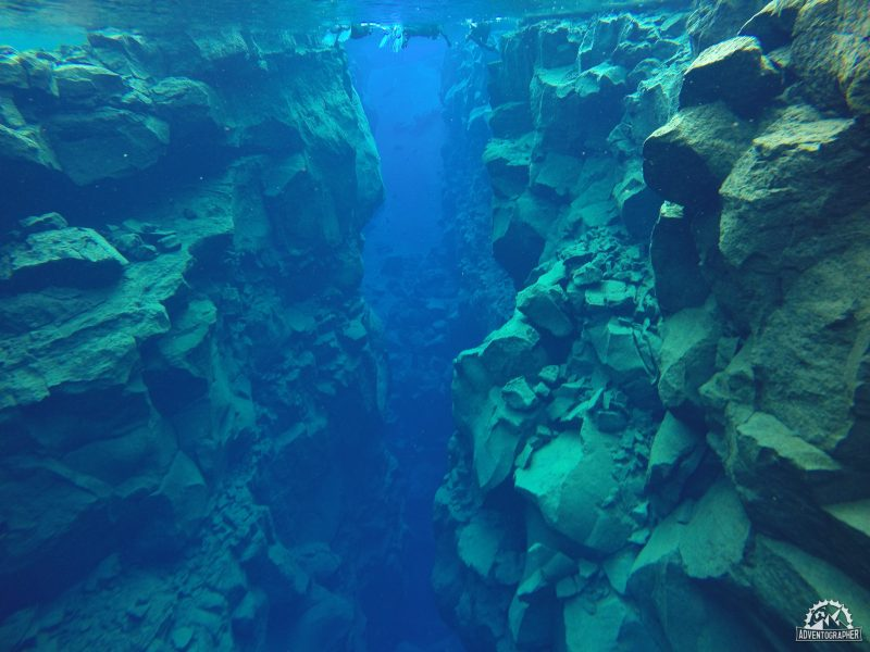 snorkelling in the silfra fissure between tectonic plates in icleand
