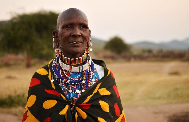 Intrepid Kenya wildlife trip - tribal woman at sunset