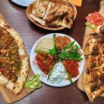 Delicious turkish food at saray restaurant laid out on the table colourful food