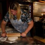 the globetrotter gp rolling the pastry . to make a pide at saray restaurant in cardiff