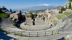 The amphitheatre in Taormina framed with the ocean and Mt Etna in the distance. A highlight of your 10 day sicily itinerary