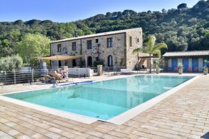 The beautiful pool and farmhouse at Cefalu turismo rurale - bargain accommodation for your 10 day sicily itinerary