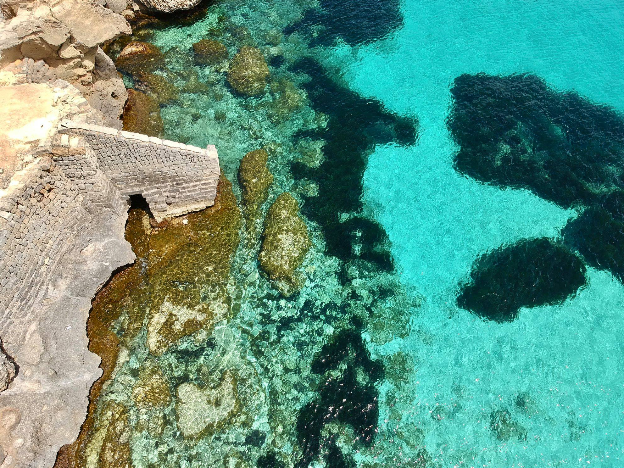 sicily ariel view of bright turqoise ocean