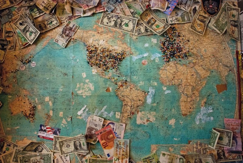 iceland cost of travel - money on a world map