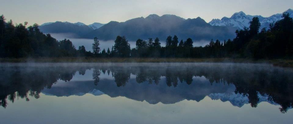 Dawn at lake matheson new zealand a bucket list destination