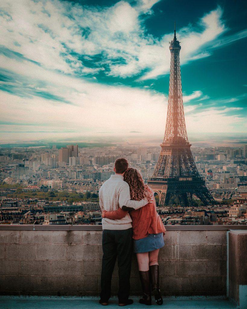 best city breaks for couples - paris couple admiring eiffel tower