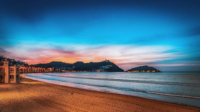 best city breaks for couples san sebastian beach at sunset