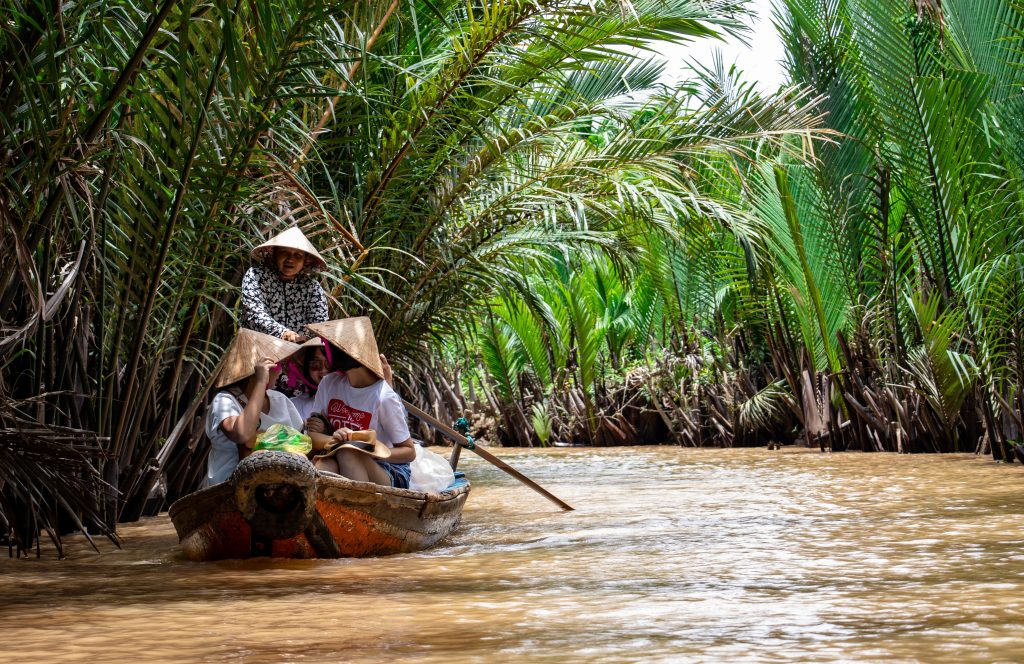 boat in the mekong delta on a cambodia and vietnam tour