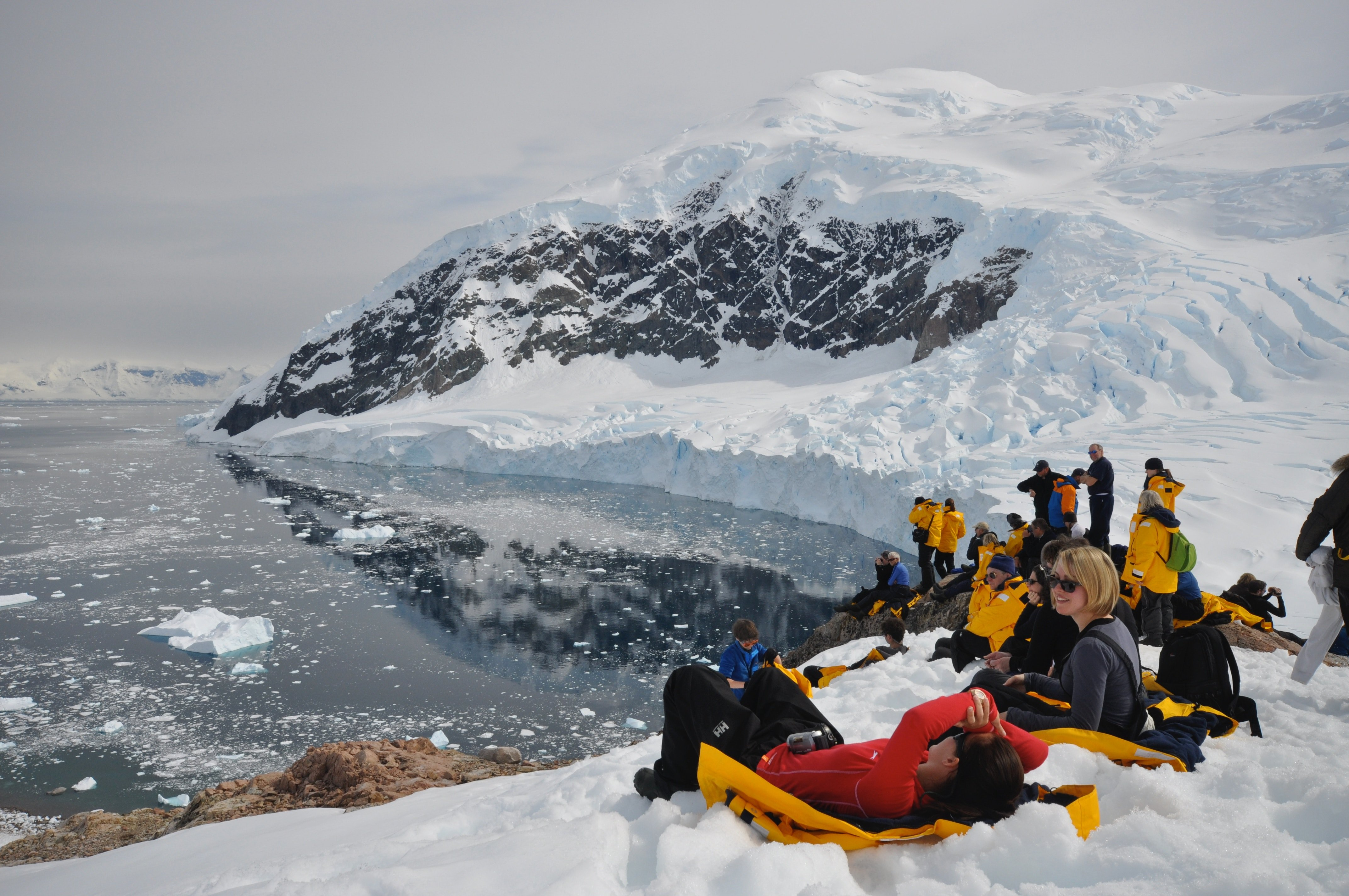 Expedition to antarctica - passengers relaxing on glaciers! a bucket list place for 2019!