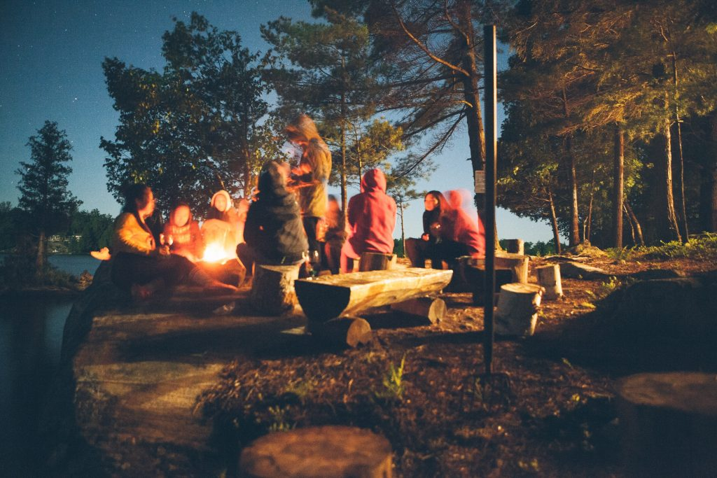 group travel for singles - campfire at night