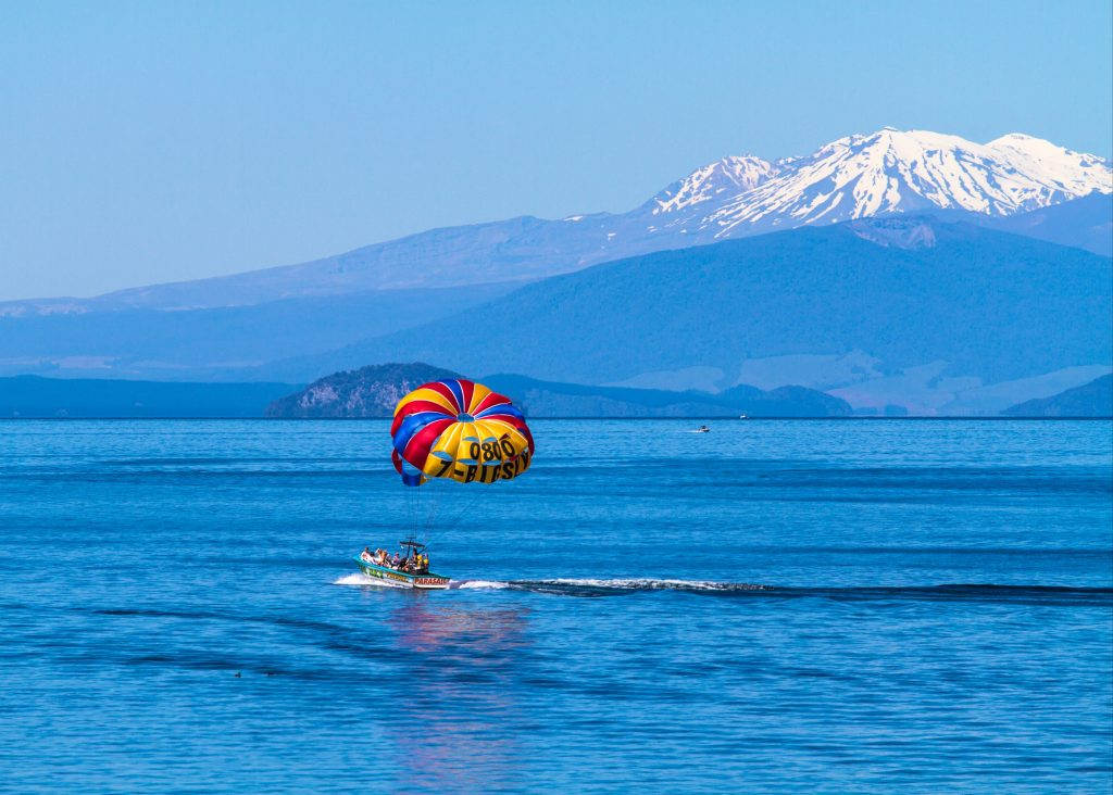 new zealand north island vs south isalnd for activities - wind sailing lake taupo