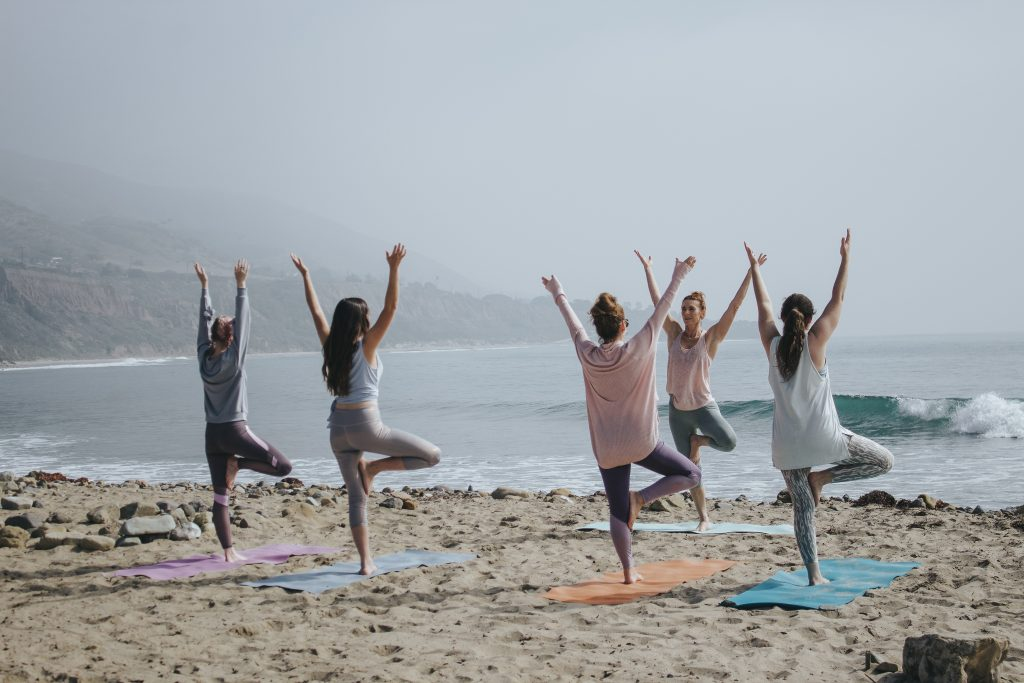 travelling with back pain yoga on the beach