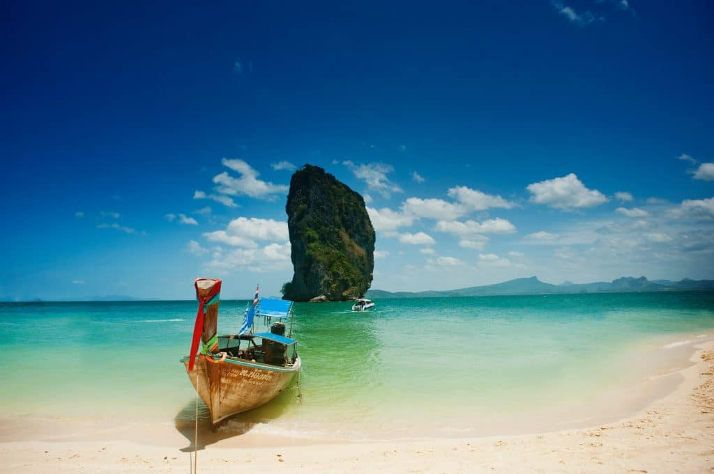 thailand beach with lone rock