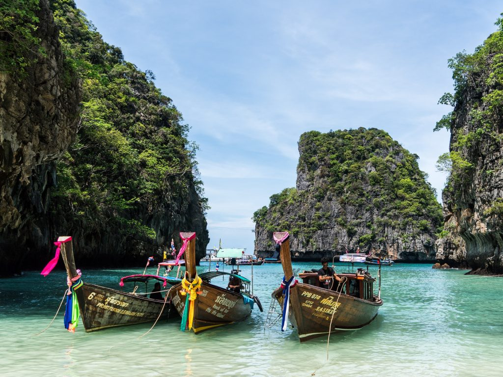 thailand beach with longtail boats