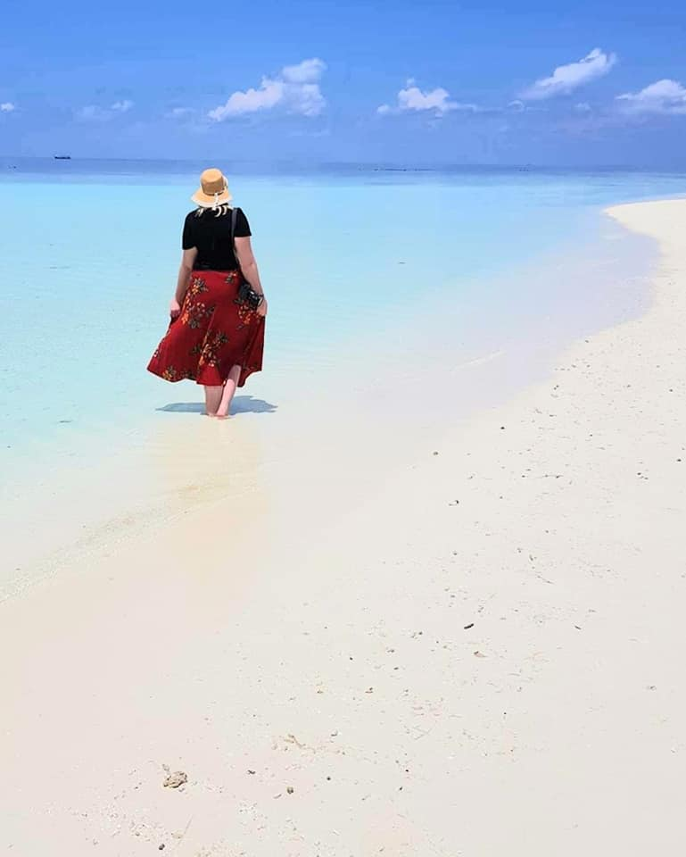 picture of the globetrotter gp in a long skirt on a sand bank