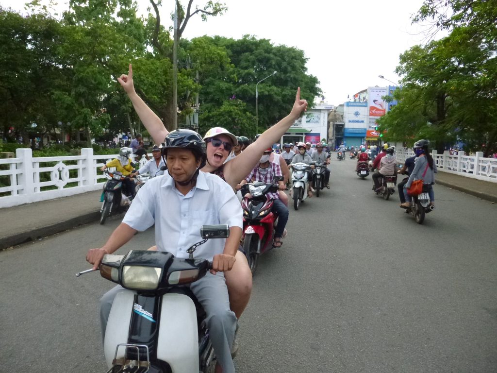 riding a motorbike in hue
