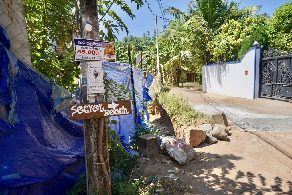 signs to secret beach marking the way from mirisssa