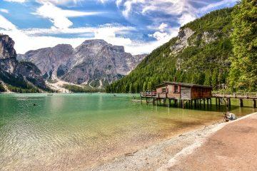Trentino beautiful lake with summer hut