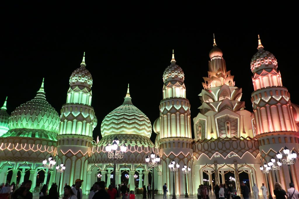 global village dubai lit up at night