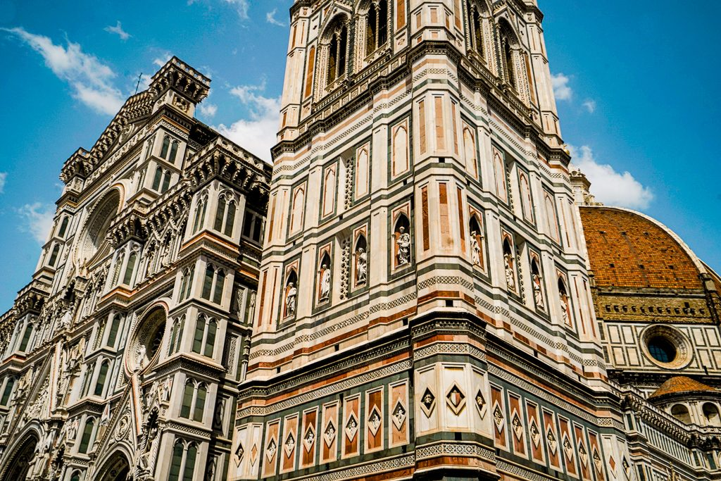 a close up photo of duomo and tower in florence