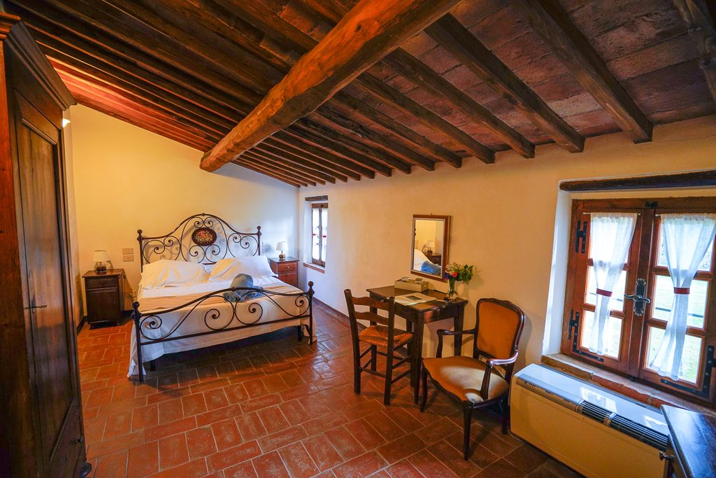 room in agriturismo with beams and old furniture