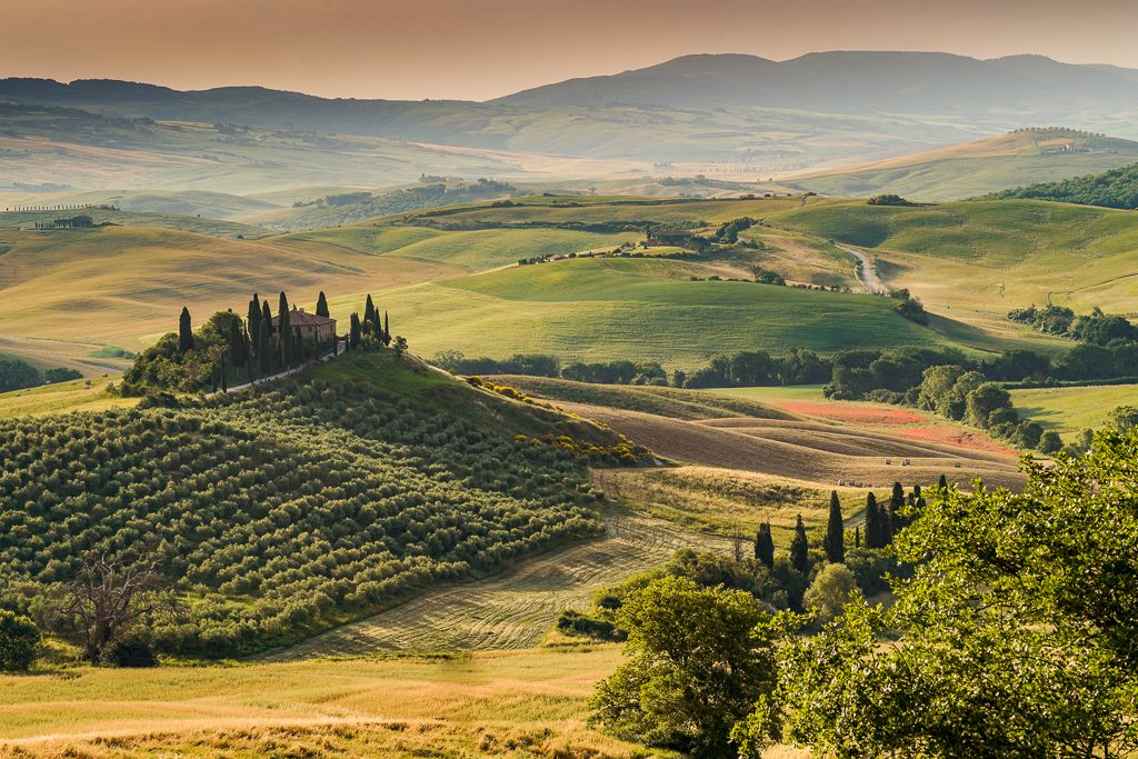 val d'orcia scenery at dawn on a tuscany road trip in italy - a must for your italy bucket list