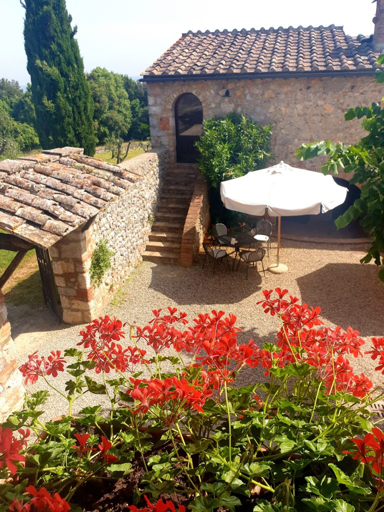 agriturismo courtyards and red flowers