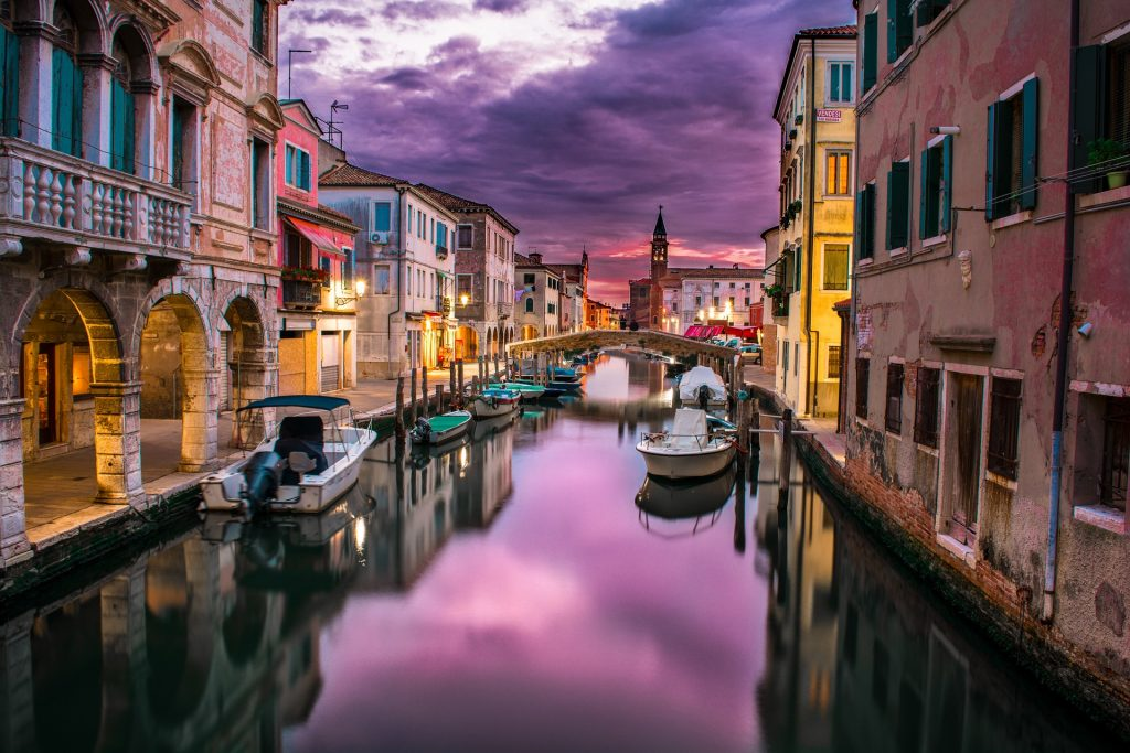 colourful sunset photo of the canals in venice italy