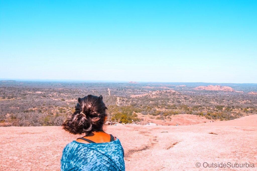 enchanted rock state usa - girl looking onto pink rock