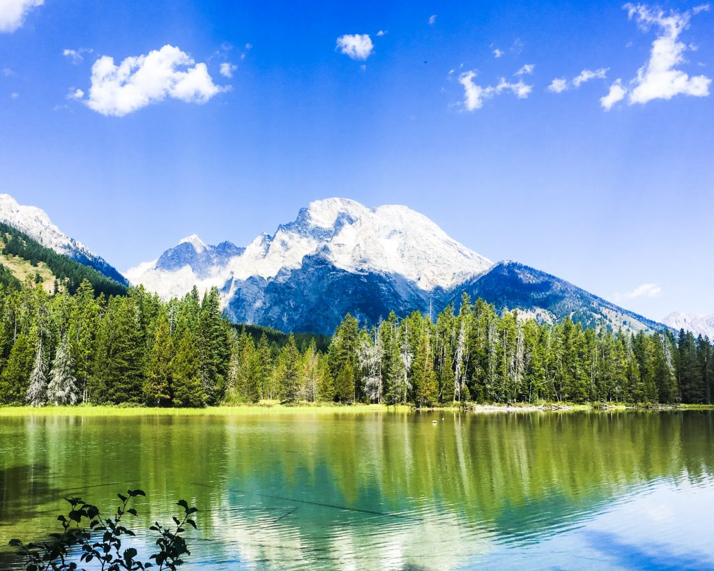 grand teton national park usa, lake with snow capped mountains and forests