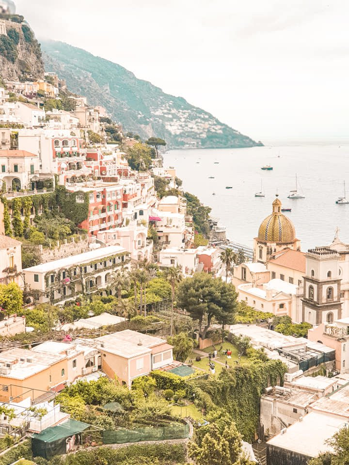 pastel houses on a hill in positano amalfi coast