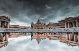 rome in the rain photography reflection of the vatican in a puddle with a stormy sky