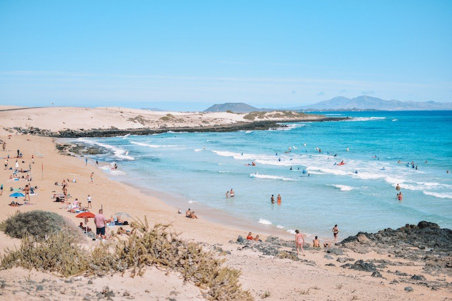 Surfing in fuerteventura spain - picture of a beach with lots of surfers