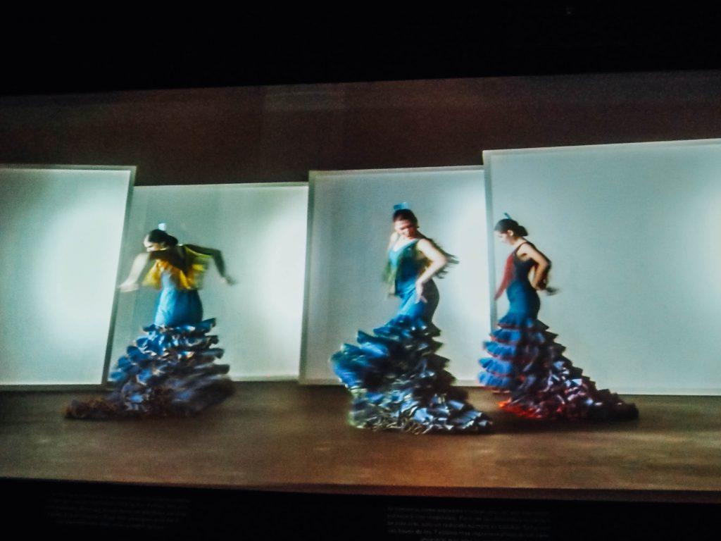 flamenco museum in seville 3 dancers in blue fancy dresses