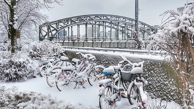 snowy winter in munich - bikes covered in snow