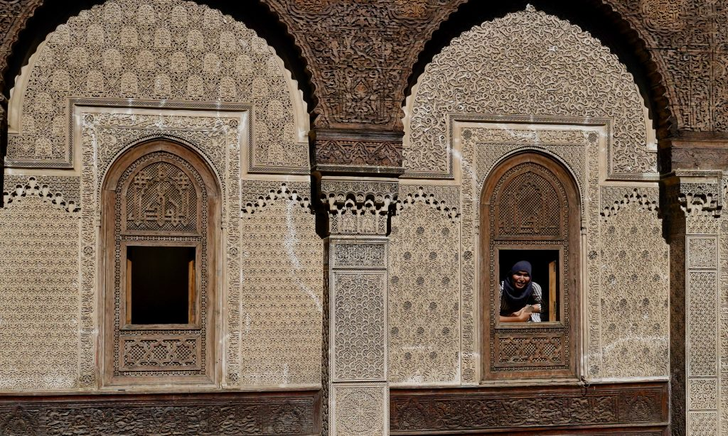 view of the wooden windows in medersa attarine in fes