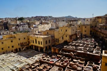 view of the tanneries from above with huge pots of coloured dyes- visiting tanneries is one of the most popular things to do with one day in fes.