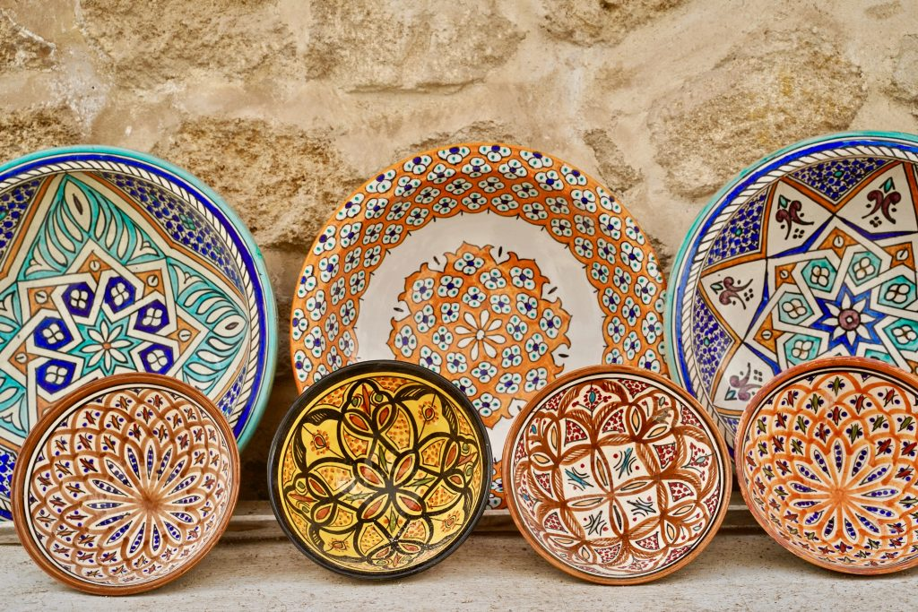 colourful moroccan plates against a a stone wall