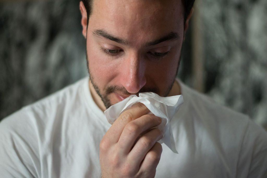 Person sick with respiratory virus coronavirus