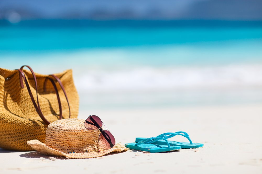 what to take to the Beach - picture of flip flops sunglasses sun hat