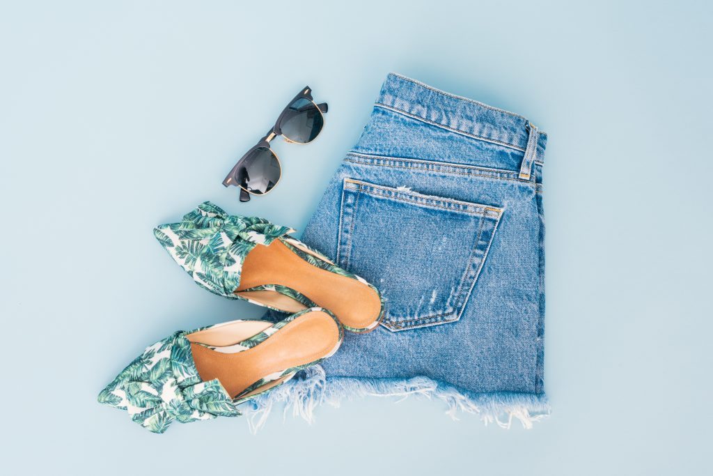 picture of packing - shorts sandals and sunglasses